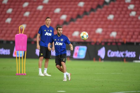 Photo for Kallang-singapore-19jul2019:Juan mata #8 player of manchester united in action during official training before icc2019 at national stadium,singapore - Royalty Free Image