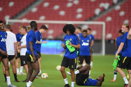 Photo for Kallang-singapore-19jul2019:Tahith Chong #44 player of manchester united in action during official training before icc2019 at national stadium,singapore - Royalty Free Image
