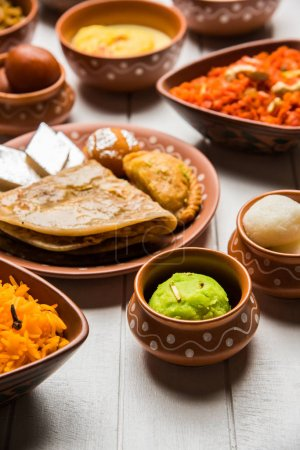 Photo for Group of Indian Sweet / mithai in terracotta bowl - Royalty Free Image