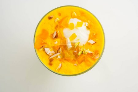 Photo for Falooda / Faluda is a popular Indian dessert - Strawberry and Mango flavoured which has Ice cream, noodles, sweet basil seeds and nuts, selective focus - Royalty Free Image