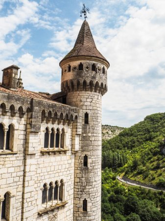 The tower of Sanctuary of Rocamadour overlooking a gorge of a tributary of the river Dordogne, Lot, France