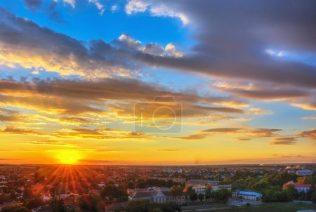 Photo for Sky with clouds over city at sunset. - Royalty Free Image
