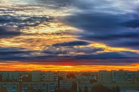 Photo for Sky with clouds over city buildings at sunset. - Royalty Free Image