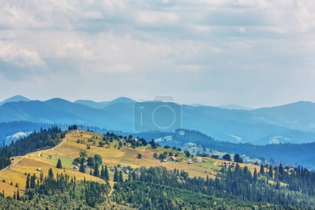 Photo for Mountains, forests and sky with clouds. - Royalty Free Image