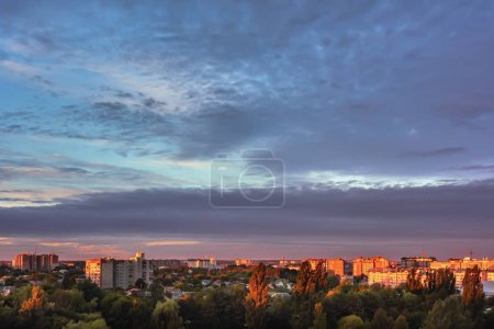 Photo for Sky with clouds over city buildings and urban park at sunrise. - Royalty Free Image