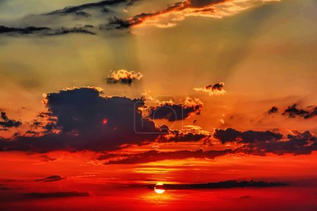 Photo for Clouds and sun at sunset. - Royalty Free Image