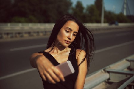 Photo for Young beautiful woman taking selfie with smartphone - Royalty Free Image