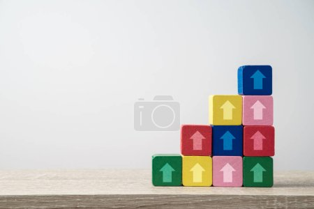 Leadership and growth concept with arrows on wooden blocks stairs. Business background