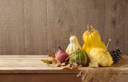 Autumn harvest background with pumpkins on wooden table