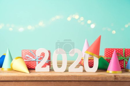 2020 New Year background on wooden table