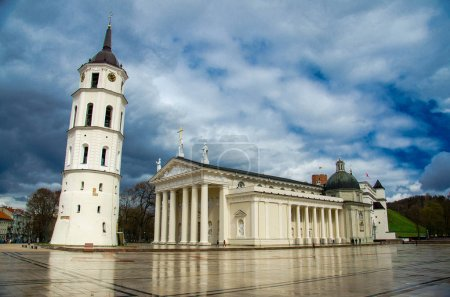 Bell Tower and Cathedral Basilica Of St. Stanislaus and St. Vladislav on Cathedral Square at the centre of Vilnius in front of blue cloudy sky, Lithuania