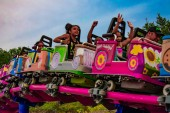 Orlando, Florida. April 7, 2019. People enjoying Cookie Drop rollercoaster family friendly attraction at Seaworld in International Drive area (3)
