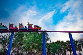 Orlando, Florida. April 7, 2019. People enjoying Cookie Drop rollercoaster family friendly attraction at Seaworld in International Drive area