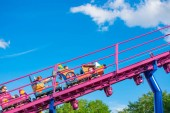 Orlando, Florida. April 7, 2019. People having fun Cookie Drop rollercoaster family friendly attraction at Seaworld in International Drive area (2)
