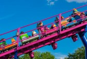 Orlando, Florida. April 7, 2019. People having fun Cookie Drop rollercoaster family friendly attraction at Seaworld in International Drive area (3)