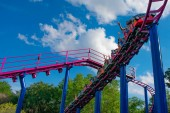 Orlando, Florida. April 7, 2019. People having fun Cookie Drop rollercoaster family friendly attraction at Seaworld in International Drive area (5)