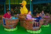 Orlando, Florida. April 7, 2019. Parent and Kids enjoying Big Bird's Twirl 'N' Whirl attraction at Seaworld in International Drive area (1).