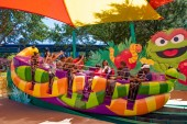 Orlando, Florida. April 20, 2019. Parents and childs having fun at Slimey's Slider in Sesame Street area at Seaworld in International Drive area (1)