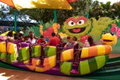 Orlando, Florida. April 20, 2019. Parents and childs having fun at Slimey's Slider in Sesame Street area at Seaworld in International Drive area (3)