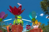 Orlando, Florida. April 20, 2019.Parents and kids enjoying  colorful flower pots aboard Abbys Flower Tower on lightblue sky background at Seaworld in International Drive area  (4)