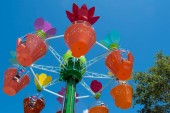 Orlando, Florida. April 20, 2019.Parents and kids enjoying  colorful flower pots aboard Abbys Flower Tower on lightblue sky background at Seaworld in International Drive area  (2)