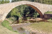 Roman bridge in Lagrasse in the south of France on a sunny day