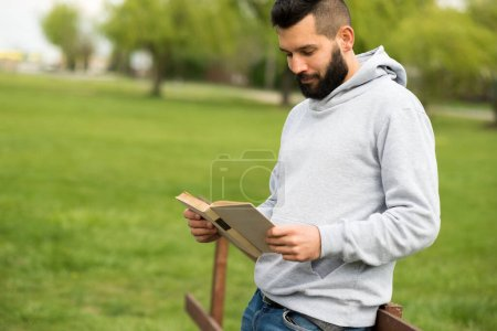 Photo for Young man with tablet computer in park - Royalty Free Image