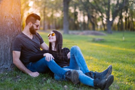 Photo for Happy young couple in park - Royalty Free Image