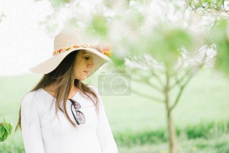 Photo for Young sexy woman in hat on a hot summer day. Looks like film photo - Royalty Free Image