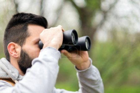 Photo for Man with binoculars in the park - Royalty Free Image