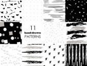 Set of 11 hand drawn trendy patterns with ink brush strokes Isolated on white and black backgrounds Vector patterns for your design
