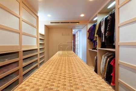 Photo for Giant walk-in closet with drawers. Nobody inside - Royalty Free Image