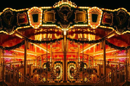 Photo for Partial view of beautiful carousel with many light at night in theme patk - Royalty Free Image