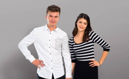 Young couple  posing with arms at hip