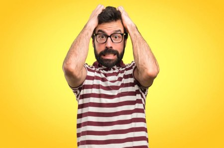 Frustrated man with glasses on colorful background
