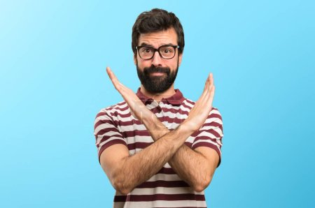 Photo for Man with glasses making NO gesture on colorful background - Royalty Free Image