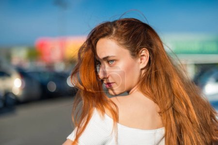 Photo for Portrait of young redhead pretty girl in outdoor - Royalty Free Image