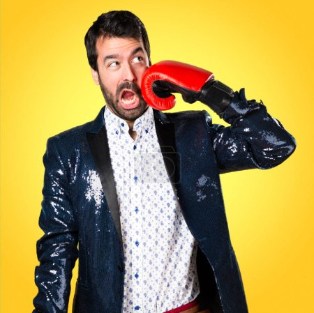 Man with jacket with boxing gloves on colorful background