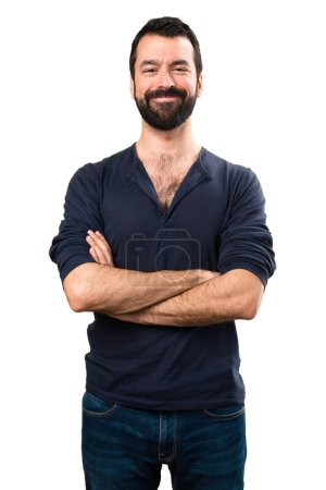 Foto de Handsome man with beard with his arms crossed - Imagen libre de derechos