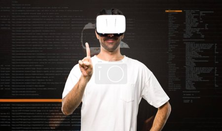 Photo for Man using VR glasses counting one inside the virtual reality mode - Royalty Free Image