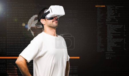 Photo for Man using VR glasses stand and looking up inside the virtual reality mode - Royalty Free Image
