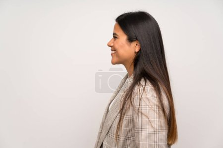 Photo for Young Colombian girl over white wall laughing - Royalty Free Image