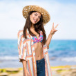 Teenager girl on summer vacation smiling and showi...
