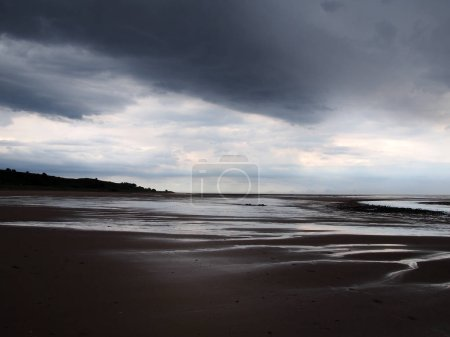 Photo for Heavy storm on a beach with dark clouds - Royalty Free Image