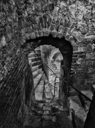 Photo for Stone stairs and doorways in an ancient underground building - Royalty Free Image