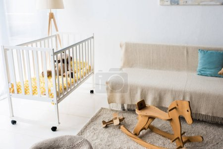 modern interior design of nursery room with rocking horse chair