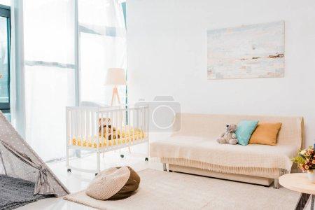 modern interior design of nursing room with crib