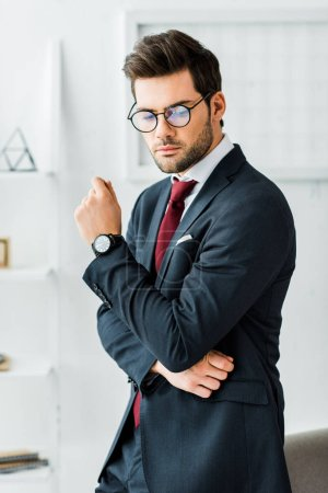 Photo for Serious handsome businessman in formal wear and glasses in office - Royalty Free Image