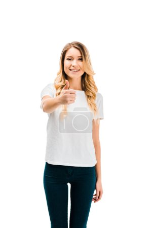 attractive blonde girl showing thumb up and smiling at camera isolated on white