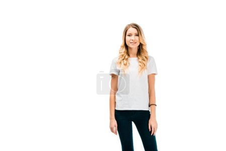 Photo for Beautiful blonde girl in white t-shirt standing and looking at camera isolated on white - Royalty Free Image